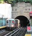 Uptown 1 train emerging from Fort George Hill tunnel into Dyckman Street station.jpg
