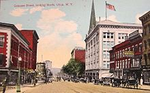 A tinted, colorized photo of wide city street