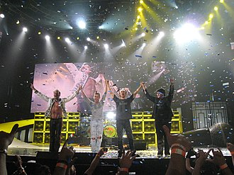 Van Halen onstage with Roth and Wolfgang in 2008. VAN HALEN 2008.jpg