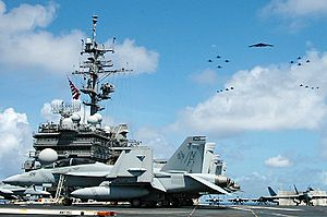 Exercise Valiant Shield - USS Kitty Hawk (CV-63) during the exercise, with fighter and bomber planes flying overhead
