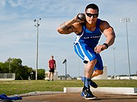 Vince Cavazos winds up for a shot put toss during a morning track and field session at the Air Force team's training camp at Eglin Air Force Base (25706987973).jpg