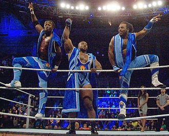 Big E (wrestler) - Big E (center) with Kofi Kingston (left) and Xavier Woods (right) as The New Day in January 2015