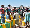 Women displayed by LRA fighting line up to draw water from a borehole