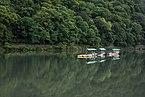 Water reflection of trees and boats on the Katsura River near Togetsukyo, Kyoto, Japan.jpg