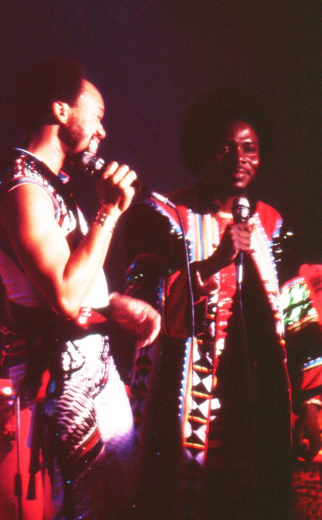 An image of Maurice White and Philip Bailey in Bohemian garb during a stage performance