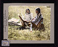 Woman and girl seated on the grass. 180.jpg