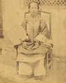 Woman with Traditional Lotus (Bound) Feet Seated with Fan. China, 1874-75 WDL1938 (cropped).png