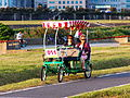 Women on Quadricycle Seeing Park 20121021.JPG
