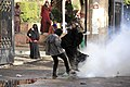 Women react to tear gas - protest at Al-Azhar University Cairo 11-Dec-2013.jpg