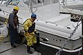 Workers wipe oil from the side of a vessel in Galveston, Texas, March 27, 2014 140327-G-BA104-003.jpg