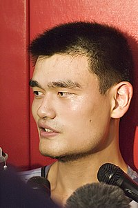 Yao answers questions from reporters