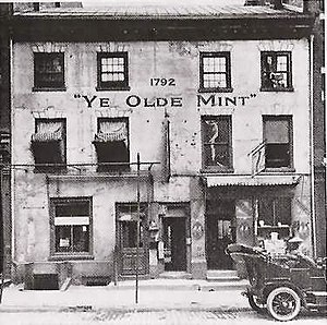 Ye olde -  The term has been in use for a long time, as shown in this 1908 image. Pictured is the First Philadelphia Mint (built 1792, since demolished).
