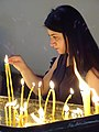 Young Woman Lighting Candles - Mayr Tachar Cathedral - Echmiadzin - Near Yerevan - Armenia (18804937809).jpg