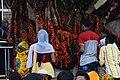 শাহপরান দরগাহ এর সামনের গাছ এ ভক্তরা.jpg