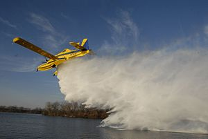 Air Tractor AT-802 - A Fire Boss on floats dropping it's load