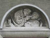1100 Laxenburger Straße 203-217 Stg. 15 - Natursteinrelief Dentist von Elisabeth Ziska IMG 7459.jpg