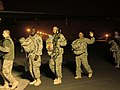 111211 - Sgt. 1st Class Brown, Staff Sgt. Renfroe, and Spc. Alfaro-Caddes wait to board their flight home to Fort Campbell, Ky.jpg