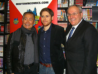 George Takei - (left to right) Takei, Archie Comics publicity director Steven Scott, and Takei's husband Brad Altman at Midtown Comics in New York.