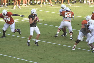 Passing pocket - A quarterback at practice, dropping back to pass.