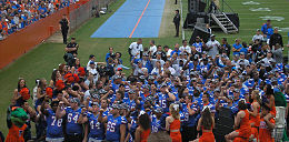 Players and cheerleaders standing together after a game