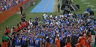 "2008 Florida Gators football team - The Gators singing ""The Orange and Blue"" at the end of a post-championship celebration on Florida Field, January 11, 2009"