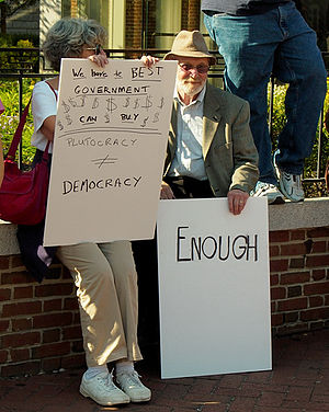 "Occupy Philadelphia - Older couple at Liberty Bell, with a message: ""Plutocracy is not Democracy"" on October 8"