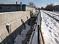 2014 02 10 Retaining Wall Progress South of Harvard Street Bridge (Medford) looking South 1 (14435259691).jpg