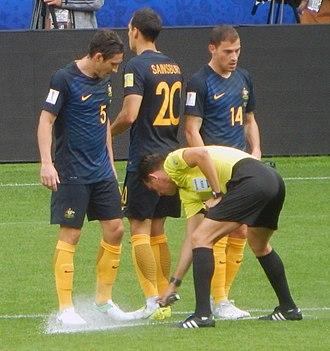 Vanishing spray - A referee applying vanishing spray before a free kick