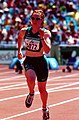 261000 - Athletics track 100m T38 Alison Quinn gold action - 3b - 2000 Sydney race photo.jpg