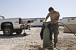 407th Expeditionary Communications Squadron Installs telephone connections for Phase two trailers DVIDS117657.jpg