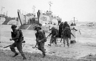 Operation Perch - Infantry of the 50th (Northumbrian) Infantry Division run ashore near La Riviere on 6 June.