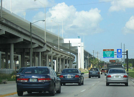 The Lee Roy Selmon Crosstown Expressway features a section that is elevated over parts of the downtown area and part of the Port of Tampa. With the even taller bridge carrying the Reversible Express Lanes of the expressway. 60 west at 15th.jpg