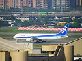 ANA JA605A arrived Songshan Airport 20111228a.JPG