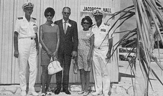 Atlantic Undersea Test and Evaluation Center - Captain Jackson, Mrs. Jan Jacobson Carter, George W. Jacobson, Jr., Mrs. Jacobson, and Admiral Brush stand in front of Jacobson Hall after its dedication by Admiral Brush.