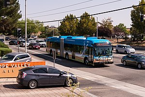 Antelope Valley Transit Authority - The first all electric zero emission articulated bus in the world, built in Lancaster, California; on its very first service run on AVTA Route 1 along 10th Street West in Palmdale, California, September 1, 2017.