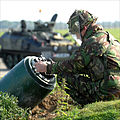 A Royal Air Force bomb disposal expert attaches a 'rocket wrench' to the tail of a 1000lb bomb during a training exercise MOD 45147755.jpg
