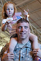A Soldier holds his daughter, after returning from a deployment to Afghanistan, during a homecoming ceremony in Oklahoma City, April 1, 2012 120401-A-ZW424-505.jpg