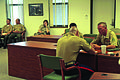 A U.S. Marine Corps screener, foreground, with the Headquarters Marine Corps Special Duty Assignment Screening Team, speaks to Marines during a visit to Marine Corps Recruit Depot Parris Island, S.C., July 7 110707-M-VG513-002.jpg