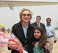 A Young Girl Attired in Pakistani National Dress Presents a Bouquet to Secretary Clinton (4808643201).jpg