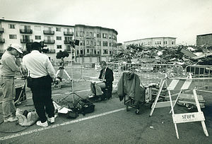 Broadcast journalism - A journalist works on location at the Loma Prieta Earthquake in San Francisco's Marina District October 1989.