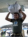 A marine with the Armed Forces of the Philippines helps load 100-pound bags of relief supplies onto a Japanese C-130 Hercules aircraft at Villamor Air Base in Metro Manila, Philippines, Nov. 27, 2013 131127-N-FE250-201.jpg