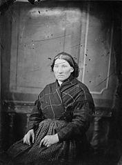 A woman wearing a shawl