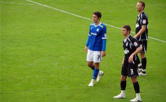 Danny Collins (footballer) - Collins (background) during his time on loan at Ipswich.