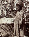 African American child picking cotton in 1895 Georgia, from- Cotton is king - A plantation scene, Georgia (NYPL b11707428-ds 02990151) (cropped).tiff