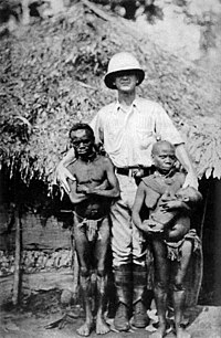 Pygmies and a European explorer. Some pygmies would be exposed in human zoos, such as Ota Benga displayed by eugenicist Madison Grant in the Bronx Zoo.