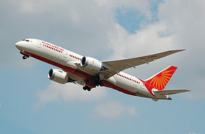 Aircraft registration - A Boeing 787-8 Dreamliner displaying Air India registration VT-ANG on the wing undersurface, on the nose wheel doors and on the rear fuselage.