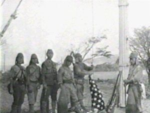 Japanese troops take down Stars and Stripes at...