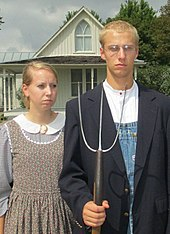 visitor's wearing period-style clothing, and with props such as a pitchfork and glasses