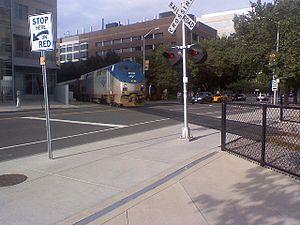 Grand Junction Railroad and Depot Company - An Amtrak Genesis locomotive crosses Main Street in Cambridge.
