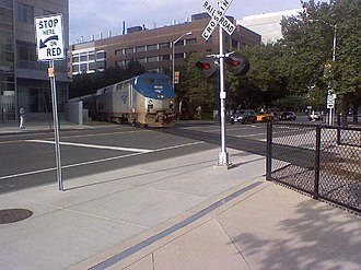 Grand Junction Railroad and Depot Company - An Amtrak Genesis locomotive crosses Main Street in Cambridge.